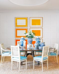 Traditional and preppy dining space with blue and white Porcelain urns and vases as centerpieces