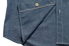 placket detail on chambray shirt by Shaabi denim