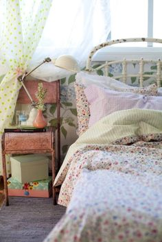 I love vintage style kids' rooms with unexpected pieces like this vintage, distressed metal chair paired with the femininity of the white iron bed.
