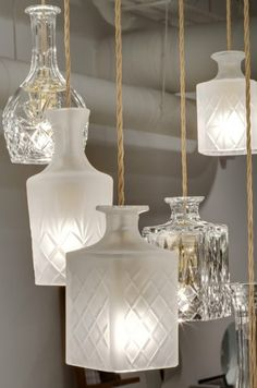 Decanter Lanterns...so pretty!  awesome in bathrooms or master