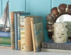 Sailing Books  Vintage sailing guides and classic adventure stories found at flea markets and secondhand-book shops provide the ultimate escape on a summer afternoon.    Read more: Nautical Home Decor - Seaside Style - Country Living