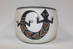 "Native American Art  184. Description: Ca. 1980s, Beautiful polychrome lizard pot by one of Lucys daughters, Emma Lewis. Very good condition. 4 x 5.  ""Emma Lewis-Mitchell was born in 1931 into the Acoma Sky City Pueblo. She is one of the daughters of the world renowned late, Lucy M."