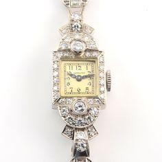 Vintage American platinum diamond ladies wrist watch by Hamilton, circa 1940. This watch has a platinum case and bracelet with diamonds at 3.50 carat...