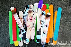 stick parts of pictures onto icy pole sticks then ask a friend to match them up