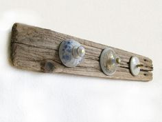coat rack made from driftwood and tea pot lids by muri___