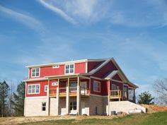 Standing seam silver galvalume metal roof red farmhouse