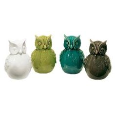 Set of four owl statues in green, white, grey, and teal.   Product: 4 Piece statue setConstruction Material:  CeramicColor: Green, white, grey, and tealFeatures:
