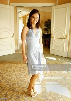 Actress Danica McKellar poses for photographs during The Old Bags Lupus Luncheon at the Beverly Hills Hotel November 5, 2003 in Beverly Hills, CA. Lupus LA auctioned off a number of celebrity hand bags.