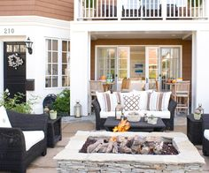 Create a cozy patio with comfortable furniture and a stone fireplace. More ideas for outdoor rooms: http://www.bhg.com/home-improvement/patio/designs/outdoor-living/?socsrc=bhgpin030413stonefirepit=9