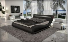Sleep with style on the Moderest Corsica- Black/White leather Bed with Headboard Lights @ www.NextDayFurnitureNYC.com