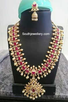 22 carat gold bridal haram and jhumkas adorned with rubies, cz stones, small pearls and south sea pearls. Ruby Jewelry, India Jewelry, Gold Jewelry, Ruby Necklace, Silver Earrings, Mango Necklace, Pandora Necklace, Big Earrings, Collar Necklace