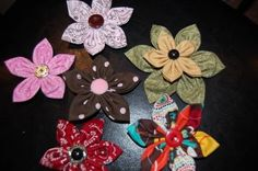 I've always wanted to know how to make these!  Fabric flower hair bows www.orsoshesays.com #crafts #sewing