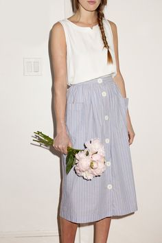 Try the long flow skirt trend! Not only does it nip in your waist, make your legs look sky-high, and give you enough air on hot summer days, but the simple ones can go with any and everything! Try wearing it with a statement necklace!