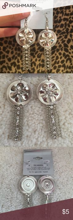 Flower dangling earrings These beautiful earrings have never been worn. They dangle nicely and have diamond rhinestoned details. Perfect condition Jewelry Earrings