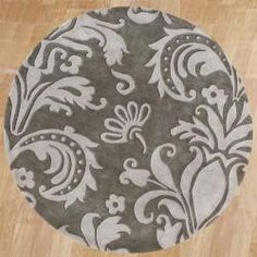 @Overstock - This stylish rug is made from 100-percent New Zealand wool that has been hand-washed and hand-tufted. In gorgeous hues of grey and light grey, this rug features a fun floral pattern.  http://www.overstock.com/Home-Garden/Handmade-Grey-Sabrina-Wool-Area-Rug-6-Round/5870732/product.html?CID=214117 $189.99
