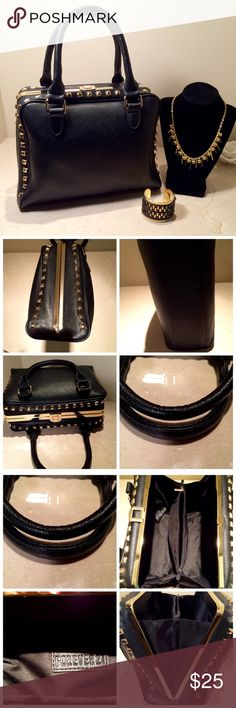"""Black Forever 21 Studded Handbag Vegan leather Forever 21 bag. Edgy with a nod to vintage styling. Gold hardware and studding. Black interior as new, mint. Exterior perfect, except one tiny scratch on metal side casing as noted in 4th image. Lever closure at top. Two interior zipper compartments and two additional pockets for cell phone, etc. 10 x12"""", with a depth of 5"""". Handle drop 6"""". Very cute bag, looks high end, and about as perfect as you can get! Forever 21 Bags Satchels"""
