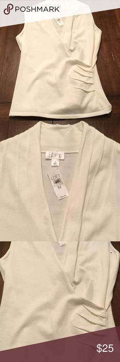 NWT Ann Taylor Loft Sleeveless Sweater Cream color v-neck sleeveless sweater. Classic piece that looks great on all! LOFT Sweaters
