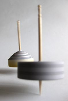 DIY spinning tops from newspaper, glue and toothpicks, just like the one in Fig's Finding Place!
