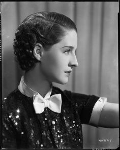 Norma Shearer :: Sparkly and pretty with a bow! | Photograph by Clarence Sinclair Bull, 1934