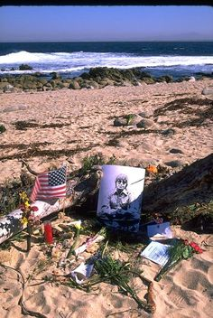 Fans leave mementos near the site where John Denver's plane crashed.