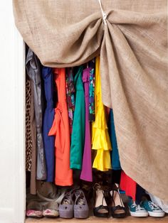 When it comes to small spaces, keeping unnecessary clutter concealed is the key to a neat room. If you don't have an armoire or closet door, try designer Alexandra Hernandez's solution: Use burlap fabric like a curtain and hold it slightly open with cotton tie-backs. Voila! Clothes stay tucked away and the room appears instantly tidier.