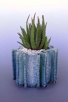 BKB Ceramics planters.  Extruded and handbuilt form with imperial blue Raku glaze.