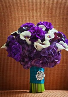 Example- Purple bouquet with white calla lilies- add burgundy and green.  Example of ribbon wrap with broach