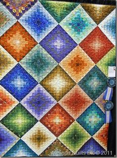 so pretty...  I think this is quilted but it'd be pretty in some crocheted granny squares too.