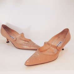 Manolo Blahnik nude patent leather pumps. Size 41.5. Please call (949)715-0004 for inquiries.