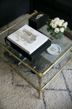 Consider your color palette: http://www.stylemepretty.com/living/2014/02/12/how-to-style-your-coffee-table/
