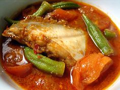 "Assam Pedas Fish recipe - Assam Pedas, or literally ""sour spicy,"" is a classic Malaysian dish. Ask any home cooks in Malaysia–Malay, Chinese, or Indian–and you are bound to get various recipes for Assam Pedas. Everyone has their own interpretation for this favorite dish and there are endless adaptations; suffice it to say, it's sour, fiery hot, and tastes extraordinarily satisfying. #malaysian"