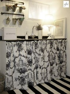 Love the skirt and the hanging galvanized buckets ~ quite charming. Toile sink skirt-for laundry room. Sink Skirt, White Cottage, Black Decor, Beautiful Space, Decoration, Sweet Home, New Homes, Black And White, Interior Design