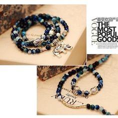 Blue lace crystal stretch bracelet with elephant symbol by VinsterFashion on Opensky