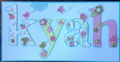 Baby girl name plate card featuring birds & flowers. Handmade by Michele Hinton.