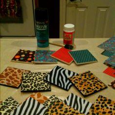 SO easy & fun! DIY coasters: Mod Podge scrapbook paper onto ceramic tiles. Spray with high gloss acrylic protective spray (at least 3 coats). Hot glue felt circles to bottom of tiles.