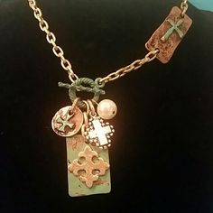 Mixed Metal Cross Necklace NWT This Super Cute necklace is made of painted turquoise patina coppertone,brass,and silvertone metals that are ALL lead free. Necklace is 20 inches with toggle clasp. NWT Jewelry Necklaces