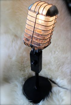 Handcrafted in Nashville, this vintage microphone light fixture is unique and beautiful with a twist. The brushed silver cage around the 25-watt tubular Edison filament bulb creates a warm glow in any space. This piece overflows with the essence of anything music...