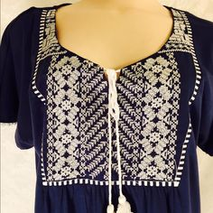 Blue peasant top with white embroidery Blue top w/white embroidery multiple Host Picks. 95% polyester 5% spandex, a little bit of stretch never hurt  Tops