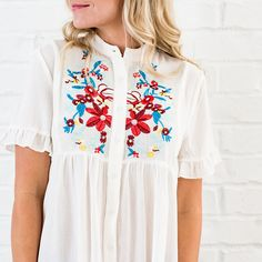 This Devri Embroidered top is too cute! The fit is super flattering!  We are in love with all the pleats along the bust line and that pleat in the back! The buttons are also functional making this top nursing friendly