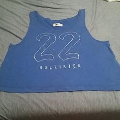 Hollister tank top NWOT. This pretty blue Hollister tank top has sequins and metallic lettering. Hollister Tops Tank Tops