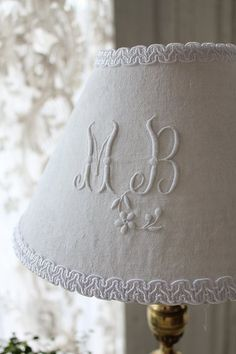 Beautiful monogram shade. A great way to use up very damaged old linen