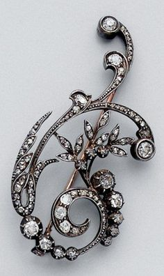 An antique gold and diamond brooch.
