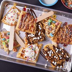 Channel your inner child and decorate a batch of sweet waffle pops for dessert. S'mores, breakfast cereal, birthday cake, PB&J--we have waffle pop recipes inspired by all of your kid food faves. Waffle Pops, Waffle Bar, Waffle Toppings, Waffle Recipes, Brunch Recipes, Dessert Recipes, Cute Desserts, Delicious Desserts, Herbs