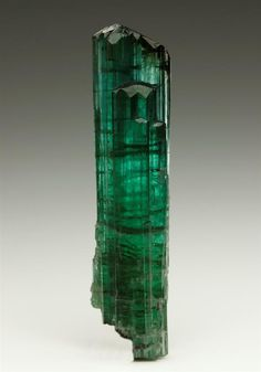 A well developed prismatic crystal of green-blue gemmy Elbaite Tourmaline measuring to 6.6cm, from the Manoel Mutuca Mine, Minas Gerais, Brazil.