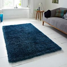 Striking, shaggy deep teal blue rug made with polyester/acrylic pile mix for supersoft looks and feel. Durable, colourfast and easy care, suitable for any room. - 5 sizes, from £31.95 See more at: http://www.landofrugs.com/rugs/plain/monte-carlo-blue-shaggy-rug.html#sthash.ArQnlCnX.dpuf