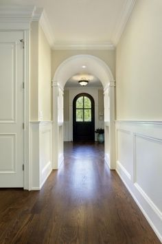 """The trim and wainscoting is all in Benjamin Moore """"white dove"""".... The height of the wainscoting is 42"""". The panels are around 40... trim is White Dove; walls Natural Cream... never paint walls and wainscotting the same white color... like the wainscot, dark floors, wide trim... Ivory White 925 by Benjamin Moore is a similar color to try."""