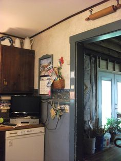 View around the kitchen prior to the 'dismantle'. You can see the gutted dining room through this doorway and the newly created/installed patio door.