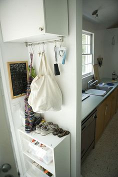 Undercarriage bar with S-hooks is a nice idea for hanging purses, bags, etc. #Organization .good idea for front hall closet