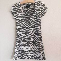 zebra print burnout tee Black/grey & white zebra print burnout tee. Maybe worn once. Like new condition! 65% polyester/25% rayon. Tops Tees - Short Sleeve