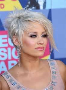 Short hair never goes out of style and can look great on almost anyone! Check out these photos of great celebrity short hair styles including Rihanna, Renee Zellweger, Katie Holmes, and Victoria Beckham the next time you're ready to go short and sassy! Short Asymmetrical Haircut, Edgy Short Haircuts, Asymmetrical Hairstyles, Funky Hairstyles, Short Hair Cuts, Short Hair Styles, Pixie Haircuts, Short Pixie, Medium Haircuts